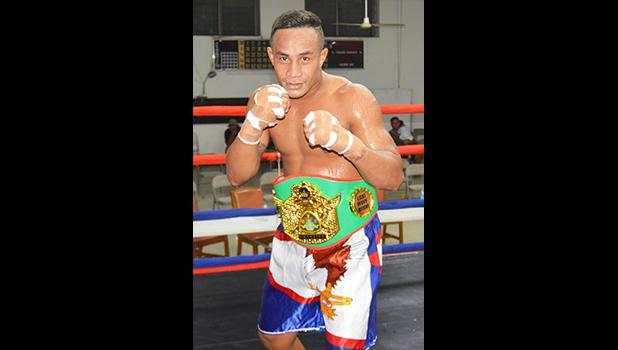 "The American Samoa undefeated heavyweight champion, Sui ""Cyclone"" Palauni after winning the vacated All Samoan title last month when he defeated Michael Fonoti of Samoa by TKO in the third round of their 8-rounds bout during the Flag Day Boxing Championship for the 2Samoas Battle. [photo AF]"