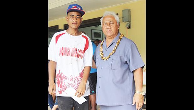 Pauli Afu, left, of Vaiala Tongan's 13-15 boys receives his MVP award for the 2017 FFAS Summer Youth League from Sen. Faiivae Iuli Alex Godinet on July 15 at Pago Park Soccer Stadium. [FFAS MEDIA/Brian Vitolio]