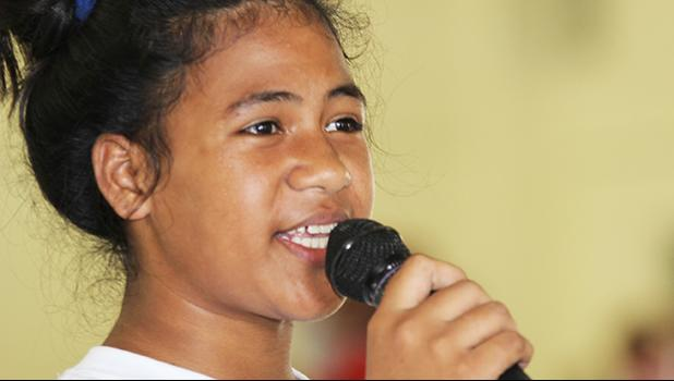 A Pava'ia'i elementary student presenter explains her schools theme and session to the judges during the ASDOE/FFAS Just Play Program finale on Thursday, April 27, 2017 at the DYWA gymnasium in Pago Pago.