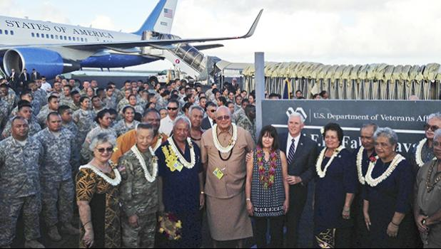 Vice President Mike Pence stands with his wife Karen as they pose for a photo with officials and U.S. service members during a refueling stop in Pago Pago, American Samoa, Monday, April 24, 2017. Pence stopped in American Samoa after leaving Australia en route to Hawaii. (AP Photo/Ken Thomas)