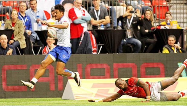 Joe Perez skips away from a Kenyan, scoring a second half try in Samoa's 26-7 trouncing of Kenya at Canada Sevens, Day 2, BC Place, Vancouver, Canada in March of this year.   [Photo by Barry Markowitz, 3/12/17]