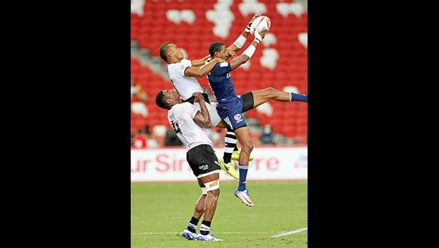 USA Eagle Perry Baker may be the HSBC Player of the Year as his athleticism has helped the Americans into a world rugby 7s power.  Singapore HSBC Sevens, Day 2, National Stadium, Singapore.  [Photo: Barry Markowitz]