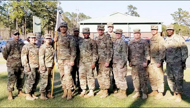"The leadership and command team of the Headquarters Company (HHC) of the 87th CSSB, of the 3rd Sustainment Brigade, Fort Stewart, Georgia (L-R): SSG POSER, J. SFC SORIANO, M. CPT NORTHRUP, R (Company Commander) SPC AUVA'A, A, SSG BAILEY J, SGT JONES M. SFC SOUTHWORTH T 1LT LOVINGGOOD J. 1LT PASCETTA N (COMPANY EXECUTIVE OFFICER) SPC MCGRAW B.  SPC MENDIOLA G. AND 1SG SMITH, as they congratulate SPC Auva'a on achieving her ""gender marker"" change.  SPC Auva'a is the First Samoan Transgender to serve openly as"