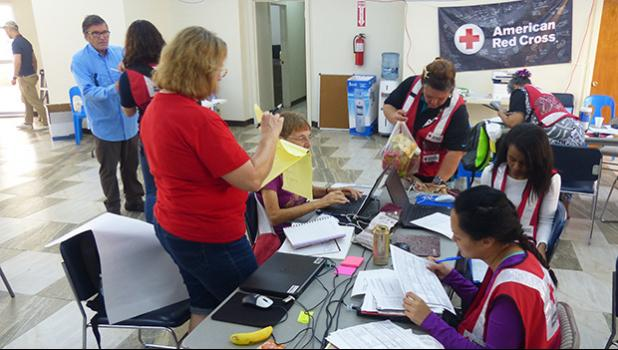 American Red Cross officials and volunteers from the US working with local Red Cross volunteers yesterday at the Tafuna office, before disaster teams head out to the field. [photo: Leua Aiono Frost]