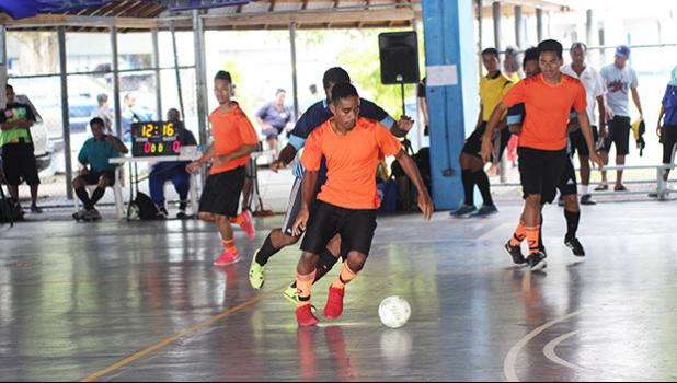 Alfred Tiatia of Royal Puma in action against the Tafuna Jets 1 during the 5th Place Tier competition of the 2017 FFAS Futsal Tournament on Monday, May 29 at the Samoana High School gymnasium in Utulei.