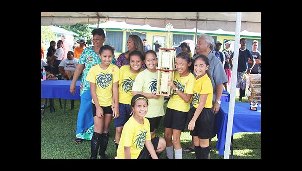 Samoa Baptist Academy's championship winning team for the 2016 FFAS Private Elementary Schools Soccer League's Girls 3-5 Division with their trophy on Tuesday, Nov. 22, 2016.  [FFAS MEDIA/Brian Vitolio]