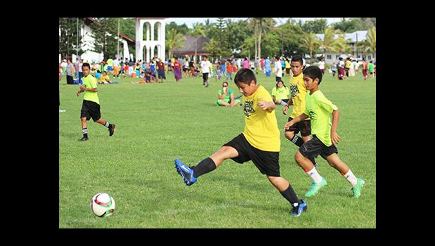 A Samoa Baptist Academy player clears the ball during a Boys Grades 6-8 Division game against Marist St. Francis in a Boy's Grades' 6-8 Division game against Peteli Academy for the 2016 FFAS Private Elementary Schools Soccer League on Wednesday, Nov. 9, 2016 at the Kanana Fou Seminary field in Tafuna.  [FFAS MEDIA/Brian Vitolio]