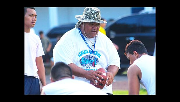 Samoana Sharks Defensive Coordinator, Maselino Tautu keeping a close eye on his defensive unit during practice yesterday evening at their school field. [photo: TG]