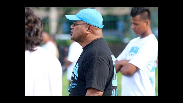 Samoana High School Head Football Coach Pati Pati calling out plays for his offense, during practice yesterday evening — they will face the Warriors tomorrow after Nu'uuli and Leone's double header match ups. [photo: TG]