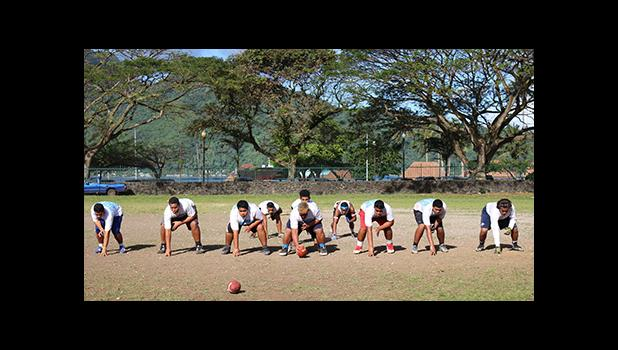 Samoana Sharks Varsity offensive unit — in a full house formation — as they rehearsed their running attack during yesterday's practice at their school field. [photo: TG]