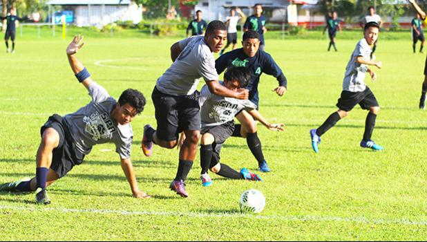 South Pacific Academy defenders scramble to clear a ball away from a dangerous opportunity to their Iakina opponents during an ASHSAA Boys' varsity soccer game on Wednesday, March 28, 2018 at Pago Park Soccer Stadium.  [FFAS MEDIA/Brian Vitolio]