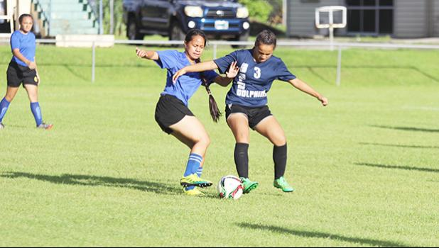 A Samoana player, left, and SPA opponent battle for possession of the ball during a 2016-17 ASHSAA Girls soccer game on Wednesday March 8, 2017 at Pago Park Soccer Stadium.