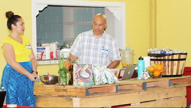 Master Chef Kenneth Kuala and his beautiful assistant and wife, Luisa, demonstrate for members of the Facebook weight-loss group SSY-Slimmer Stronger You, how to cook and make sauces and salad dressings using healthy, locally grown ingredients. The demonstration was part of the first ever SSY Meet & Greet event that took place December 8 at the VA Center in Tafuna.