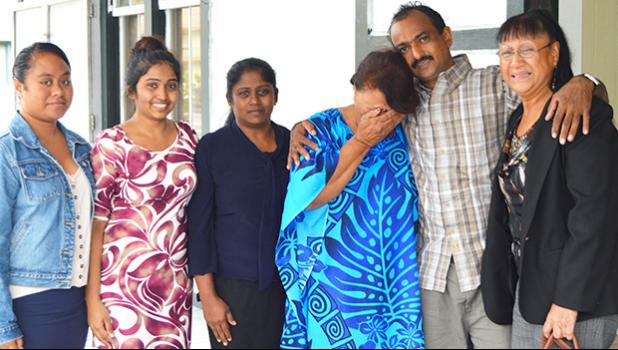 Salend Singh (second from right) with his family including his wife and daughter outside of High Court after the jury found him not guilty to all four charges against him. [photo by AF]