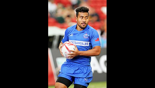 Tila Mealoi scores Samoa's second try and exudes a sigh of relief as Manu Samoa went on to upset powerful Japan 26-14 at the Singapore HSBC Sevens, Day 2, National Stadium, Singapore.   [Photo: Barry Markowitz]