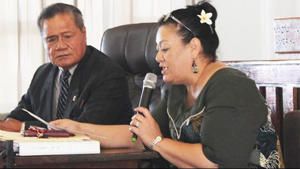 Senate President ProTem, Nuanuaolefeagaiga Saoluaga Nua (left) lookong on, as Senate legal counsel Mitzie Jessop-Ta'ase reads for senators, local law which requires Fono approval of money in the law enforcement fund to finance purchases of new police vehicles. [photo: FS]