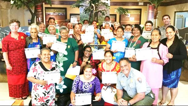 """Twenty senior citizens from the Territorial Administration on Aging (TAOA), along with director Evelyn Lili'o-Satele (far left), became the first class of TAOA seniors to be appointed 'Senior Rangers' of the National Park Service. The group's members have pledged to """"explore, learn about, and help protect the National Park of American Samoa and all National Parks"""".  [photo: courtesy]"""