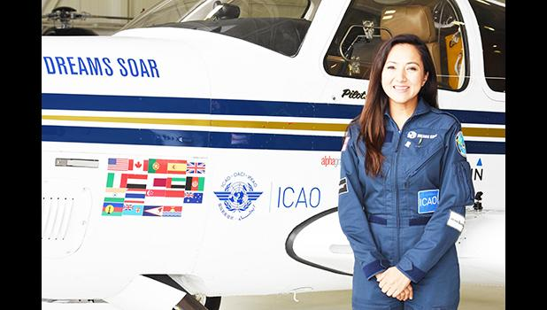 This 2017 photo provided by the non-profit group Dreams Soar, shows female aviator, Shaesta Waiz, with her Dreams Soar single engine Beechcraft Bonanza A36 plane. Waiz began her global solo flight in May this year from Dayton, Florida. She landed at Pago Pago International Airport last Friday afternoon for a two-day stop over to refuel and rest before departing yesterday. On the plane's body are flags of some of the countries and territories where she made  stops, including the American Samoa Flag — shown o