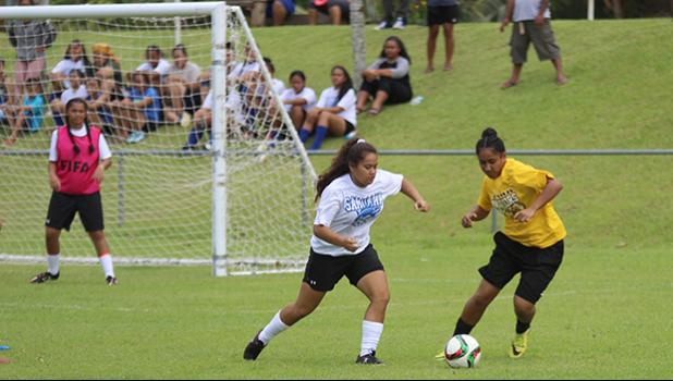 Samoana's Deidra Steffany defends against a Tafuna Warrior opponent during an ASHSAA varsity girls' soccer game on Saturday, Feb. 24, 2018 at Pago Park Soccer Stadium.  [FFAS MEDIA/Brian Vitolio]