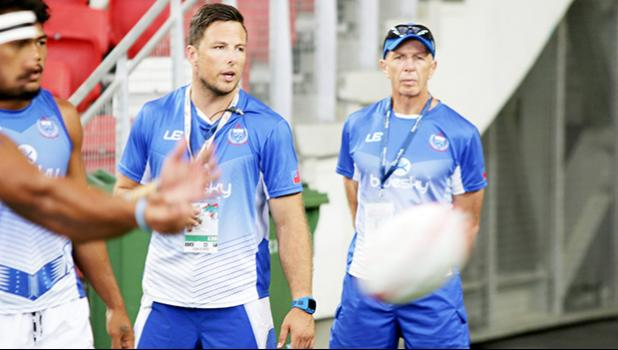 Sir Gordon Tiejtens and his acting trainer son put Manu Samoa through pregame warm ups at the Singapore Sevens, Day 1, National Stadium, Singapore. [Photo: Barry Markowitz]