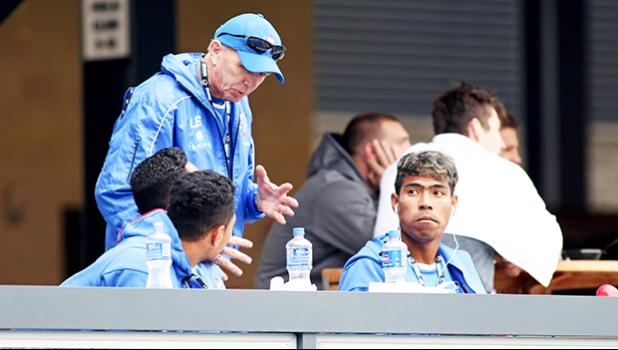Legendary Rugby 7s Coach, Sir Gordon Tietjens, coaches up his Manu Samoa players while they snack between games at the SiliconValley 7s, Avaya Stadium, San Jose, California, USA.  [Photo: Barry Markowitz]