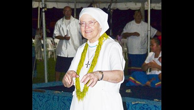 Sister Sheila, who traveled from Britain to join the rest of American Samoa to celebrate the 30th Anniversary of Hope House, got to dance on the grounds she walked and served once before, Fatuoaiga, Heart of Families. She was instrumental in the opening of Hope House in 1987.  [photo: Leua Aiono Frost]