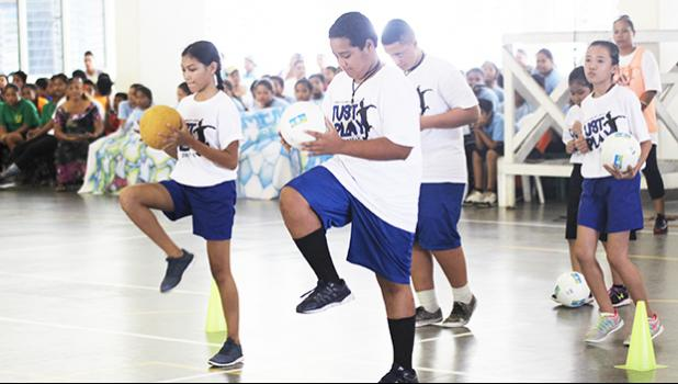 St. Theresa students perform a skill from the theme of their presentation during the ASDOE/FFAS Just Play Program finale on Thursday, April 27, 2017 at the DYWA gymnasium in Pago Pago.