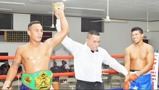Sui Palauni of American Samoa (left) won the vacant light heavy weight All Samoan Championship Title against Michael Fonoti of Samoa by technical decision during the Flag Day 2017 Championship that was for the Governor's Cup and championship title last Saturday night at the old Bowling Alley in Tafuna. [photo: AF]