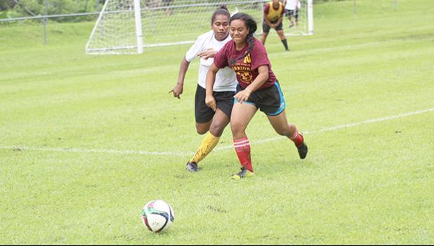 Tafuna's Shaloriana Tauaofa successfully defends against the Cougars' Adi Muanivanua during their ASHSAA Girls varsity soccer game on Monday, Feb. 4, 2017 at Pago Park Soccer Stadium.  [FFAS MEDIA/Brian Vitolio]