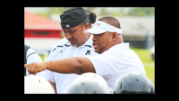 Tafuna High School's new Head Football Coach Kolose Ili speaking to his players after their victory over the Sharks this past weekend – where he emphasized humbleness, humility, and that it was only the beginning.  [photo: TG]