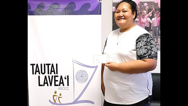 Tauga accepting the ASCCC stipend for her dad – Fala Tiatia who is one of the  two men recently diagnosed with colorectal cancer, which is on the rise in American Samoa. [courtesy photo]