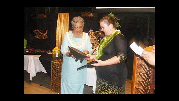 First lady Cynthia Malala Moliga (left) during the gift and award presentation to the 2017 Territorial Teacher of the Year, Dana Love-Ili, at the TTOY celebration sponsored by the Dept. of Education at the Tradewinds Hotel Pavilion last Friday evening.  [photo: FS]