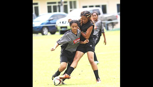 A Royal Puma player attempts a tackle against a Taputimu Youth opponent in a Match Day 7 game of the women's 2017 FFAS National League at Pago Park Soccer Stadium on Saturday, October 28, 2017.  [FFAS MEDIA/Brian Vitolio]