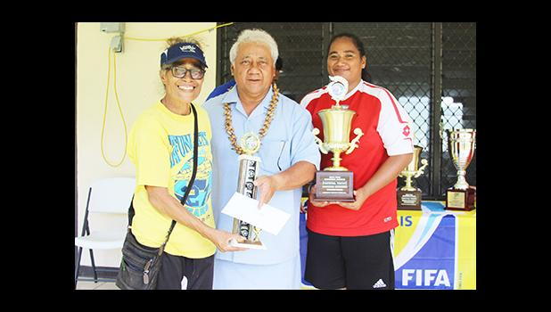 Tafuna Jets' club president Naomi Oney, left, and the women's team captain and league MVP Beulah Oney, right, receive their awards from FFAS President Faiivae Iuli Alex Godinet during the awards ceremony for the 2016 FFAS National League that ended on November 26, 2016 at Pago Park Soccer Stadium.  [FFAS MEDIA/Brian Vitolio]