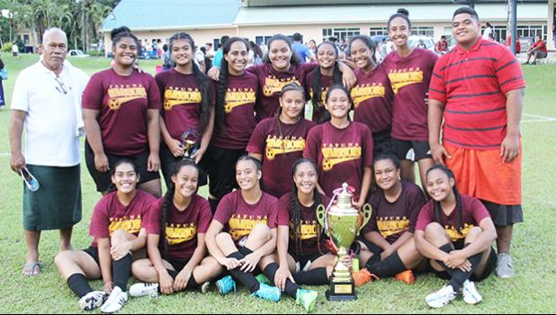 The Tafuna Warriors' Girls Junior Varsity team, champions of their division after winning against the Samoana Sharks in the championship game that went to a penalty kicks shootout (5-4) to determine the winner after the game ended in a 1-1 draw.  [FFAS MEDIA/Brian Vitolio]