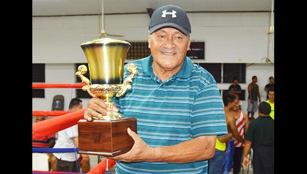 President of the American Samoa Boxing Council (ASBC) Toleafoa Henry Tavake with the Governor's Cup that the American Samoa boxing team has now won back-to-back during this year Flag Day 2017 Boxing Championship against Samoa that was held at the old Bowling Alley in Tafuna last Saturday night. [photo: AF]