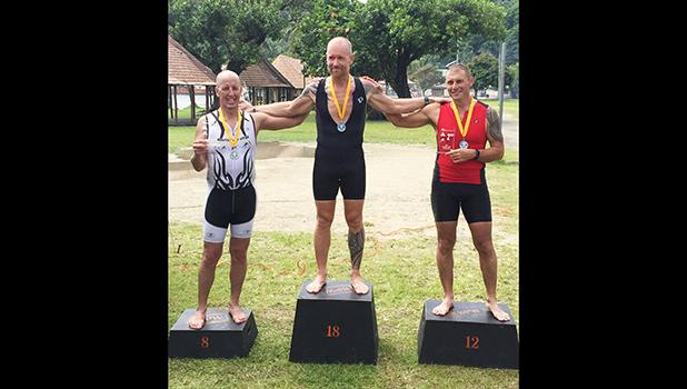 Winners of the Olympic Triathlon Course (1 mile swim, 24.6 mile bike, 6.2 mile run) that took place last Saturday at Utulei Beach: third place Matt Bracken, second place Patrick McEntire and first place Richard Birgander.  [photo: Ese Malala]