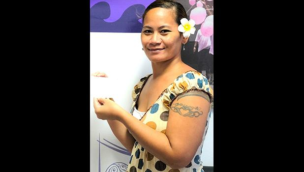 Moli accepting the ASCCC stipend her dad, Fiaui Uikilifi who is one of the  two men recently diagnosed with colorectal cancer, which is on the rise in American Samoa. [courtesy photo]