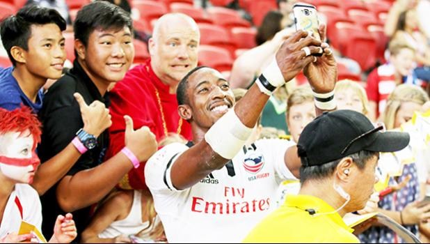 Perry Baker's blazing speed has made him the hottest star on the HSBC 7s Circuit, always asked for selfies here at the Singapore Sevens, Day 1, National Stadium, Singapore [Photo: Barry Markowitz]
