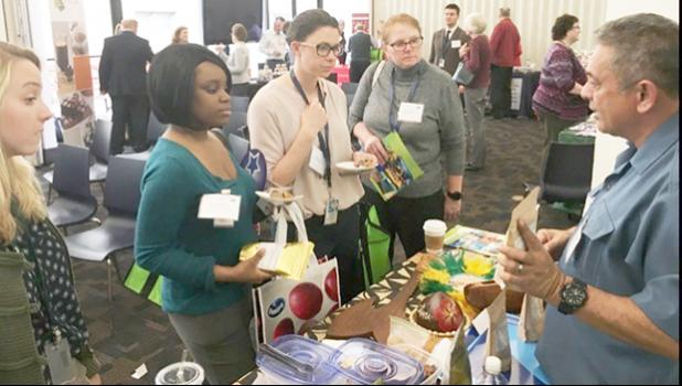 Rep. Su'a Alexander E. Jennings (right) speaking to participants of the Nov. 16 first-ever U.S. Department of Agriculture (USDA) Dried Fruit Expo in Washington, D.C.  Su'a also gave a presentation on the possibilities and potential for breadfruit and banana flours grown and made in American Samoa. [photo: Tom Payne]