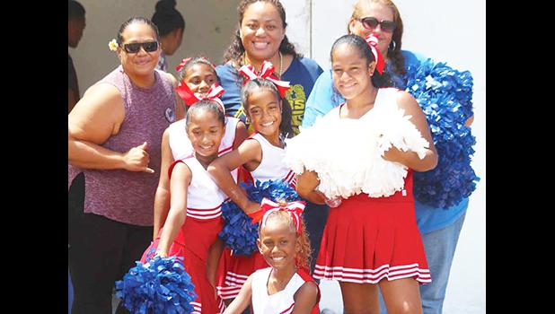 The Cheerleading squad for the American Youth Football of Samoa (AYFS) posing for a group photo during halftime of the Rams and Packers Semi-final match up. Read full story in tomorrow's Samoa News issue. [photo: TG]