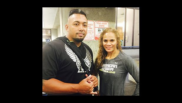 Coach Shane Lyman of Hawaii Elite Athletic Training/ Mana Barbell Gym stands here with Ursula Te'o Martin of American Samoa. Ms. Te'o Martin will be representing the territory in Tahiti this week at the 2016 South Pacific Bodybuilding Championships and Figure Competition.  Seen here, they are Tahiti-bound, ready to board the flight in Honolulu.  [courtesy photo]