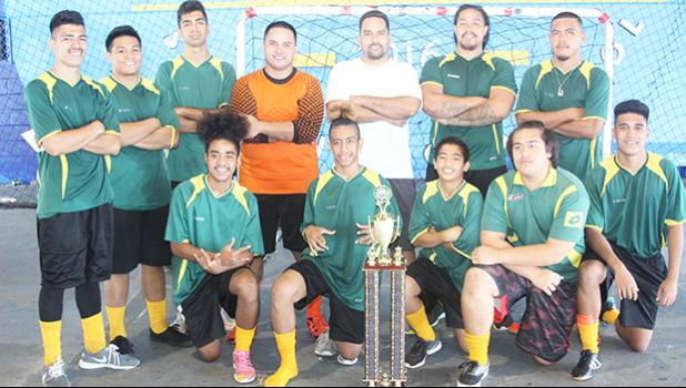 Utulei Youth, the 2017 FFAS Futsal Tournament champions with their trophy after the 2- 1 shootout (1-1) win against Pago Youth 1 on Monday, May 29 at the Samoana High School gymnasium in Utulei.