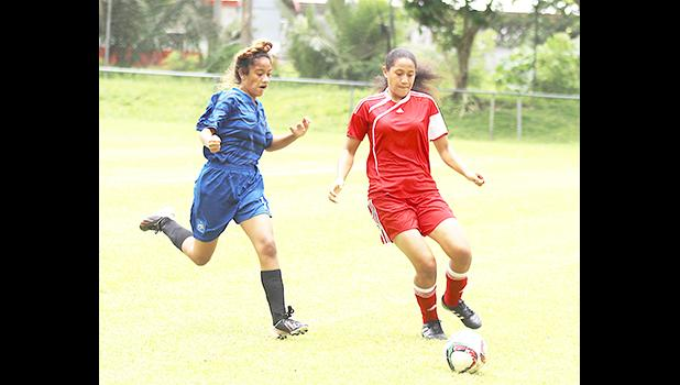 A Vaiala Tongan defender in action against a Green Bay opponent during the women's FFAS National Cup challenge game at Pago Park Soccer Stadium on Saturday, October 28, 2017.  [FFAS MEDIA/Brian Vitolio]