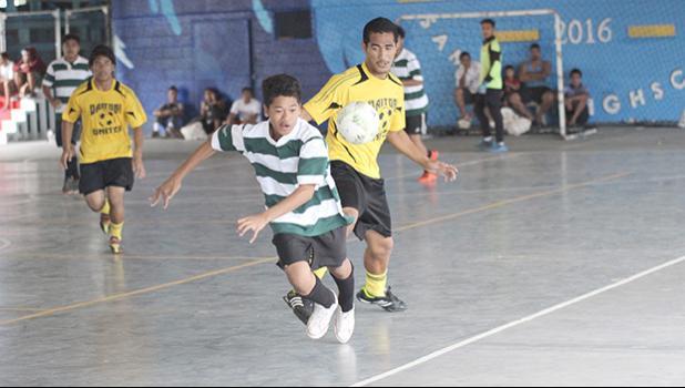 Vaha Tua of Vaiala Tongan in action against Vaitogi United on Match Day 3 of the 2017 FFAS Futsal Tournament at Samoana High School's gym in Utulei on Saturday, May 20, 2017.  [FFAS MEDIA/Brian Vitolio]