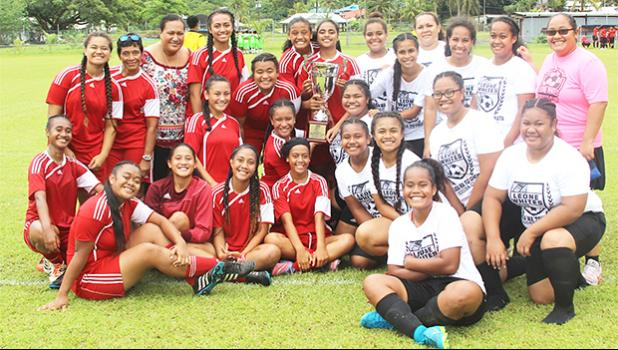 The Vaiala Tongan and Ilaoa & To'omata women's teams are pictured with the women's FFAS National Cup after their game on Saturday, Sept. 23, 2017 at Pago Park Soccer Stadium. Vaiala Tongan took the cup away from Ilaoa & To'omata following a 6-0 win. See story in today's Sports section. [FFAS MEDIA/Brian Vitolio]