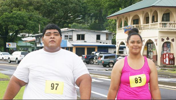 "Immanuel, an 18-year-old of Masefau, who participated for the first time in the 5k run last Saturday starting from the South Pacific Watersports Fitness to Nuuuli and back. ""This is my first time and it was hard but I will stuck with it,"" she told Samoa News. [photo: Ese Malala]"