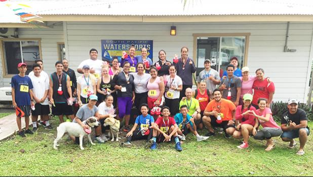 Locals and visitors who participated in the 5k and 14k Heart N Sole fun run hosted by Paula and Michael McDonald of South Pacific Watersport and Fitness on Saturday at Utulei Beach.  [photo: Ese Malala]