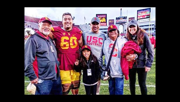 Trojans #60 Viane Talamaivao with his grandparents Tasi and Imeleta Asuega and uncle Johnny Nansen, Assistant Coach for the USC Trojans.  [Courtesy photo]