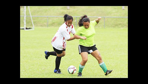 A Vaiala Tongan player (left) and Lion Heart opponent fight for possession of the ball during a women's game on Match Day 5 of the 2016 FFAS National League on Saturday, Sept. 17, at Pago Park Soccer Stadium.
